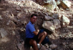 Bob Landstrom studying petroglyphs in Arizona 1992